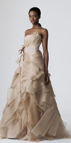 DIEDRE    Pale nude strapless full A-line tissue organza gown with asymmetrically draped bias tiered origami skirt, back bows, and nude grosgrain bow at natural waist