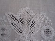 Tulip embellishment with uniform half-eyelet scallops. The thread weight and the density of the stitches are both correct. White Embroidery, Beaded Embroidery, Cross Stitch Embroidery, Embroidery Patterns, Hand Embroidery, Fall Cross Stitch, Cross Stitch Samplers, Drawn Thread, Easter Cross