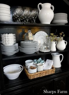 White dishes on display on hutch shelves                                                                                                                                                                                 More