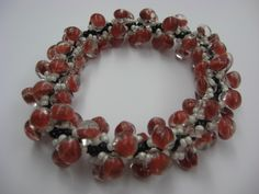 Simple Spiral Bracelet in red boro, designed by Cheryl Erickson.  Instructions and kits available in this and other colors from www.artisticbead.com.