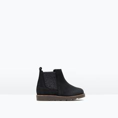 LEATHER BOOTS WITH ELASTIC SIDES