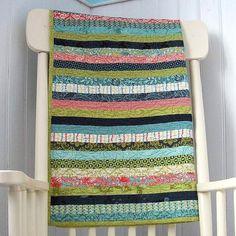 Beautiful strip quilt!