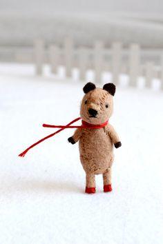 I cannot begin to say how much I love this little bear.  honey bear - wool felt miniature bear by royalmint. $28.00, via Etsy.