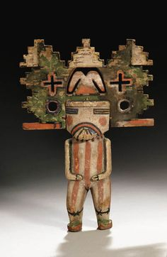 AN IMPORTANT EARLY HOPI POLYCHROME COTTONWOOD KACHINA DOLL   Representing a dancing Shalako Mana, sold $107,000 at Christies auction sale 1st of december 2008