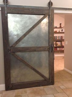 Metal Barn Doors Industrial sliding barn door using aged sheet metal and distressed new lumbar. Chalkboard on back - Door Metal Barn, Barn Wood, Metal Building Homes, Building A House, Metal Homes, Pole Barn Homes, Corrugated Metal, Metal Buildings, Interior Barn Doors