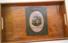 13 x 6 3/4 x 3/4 serving tray with cross stitch pattern underneath a high shine resin