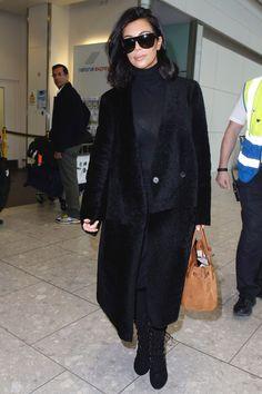 Kim Kardashian arrives at Heathrow Airport on Feb. 25, 2015, in London.   - Cosmopolitan.com