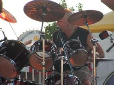 The drummer playin and singin to the music ...  Full Armor Classic Rock Band