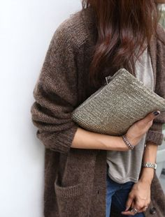 Wool cardigan, tee, jeans and metallic clutch. Photo (via Bloglovin.com )