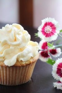 coconut cupcakes with mango whipped cream frosting