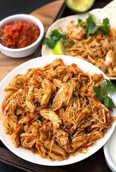 Instant Pot Salsa Chicken is Mexican flavored shredded chicken breast that you can use for tacos, burrito bowls, and casseroles. Lots of flavor, and this pressure cooker shredded chicken is so useful!
