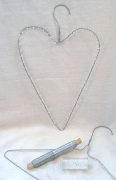 just wrap it in tinsel or lights or ivy, makes a very cute decoration. now i can put all those annoying metal hangers to good use! Valentines Day Decorations, Valentine Crafts, Christmas Crafts, Wire Hanger Crafts, Chicken Wire Crafts, Deco Boheme, Metal Hangers, Lace Heart, Heart Crafts