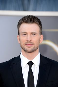 Chris Evans - that slight bit of gray that's starting to show up in his stubble... so sexy!