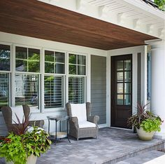 Porch. Front Porch. Shingle house front porch. Front porch ceiling. Front porch stone flooring. Front porch door. Front porch furniture. Front porch chairs. Front porch windows. #Frontporch Dwellings Inc.