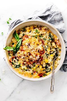 "This Creamy Sweet Corn Cauliflower Grits recipe makes for a flavor packed one pot meal! Vegetarian Comfort food made lighter and healthier! Cauliflower riced into ""grits"" with sweet corn, Gruyere cheese, spinach, basil, onion, and more! Ready in 30 minutes"