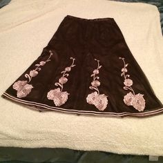 "EMBROIDERED BEAUTY! NWOT Skirt is brown with pink embroidered roses/flowers. Fully lined, as seen in the picture. A-line shape Concealed zipper and hook on the side of the skirt. Measurement from top to bottom is approximately 27"" Skirt material: 100% polyester ‼️ FIIRM PRICE‼️ ✳️Bundle option✳️ No trades Nygard Collection Skirts A-Line or Full"
