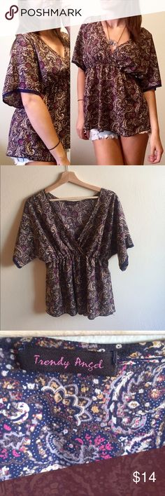 Trendy Angel Top Trendy Angel Top! Paisley pattern with dark blue lace trim around the sleeves ! One size fits most! Stretchy waist and breathable material ! Can be dressed up or be worn for a casual night! 🌻25.5in from shoulder to bottom of top🌻14.5in across waist but is elastic!🌻smoke/pet free home🌻☀️ FEEL FREE TO MAKE AN OFFER! Bundle two or more items for 20% off🌻☀️ Trendy Angel Tops