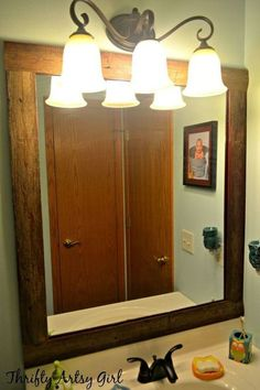 easy diy reclaimed wood frame on a builders grade mirror, bathroom ideas, home decor, repurposing upcycling, small bathroom ideas