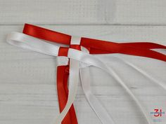 Braiding the ribbon lei with red ribbon loop on top. Ribbon Lei, Diy Ribbon, Ribbon Crafts, Ribbons, How To Make Leis, Graduation Leis, Graduation Cards, Braided Hairstyles For Wedding, Prom Hairstyles