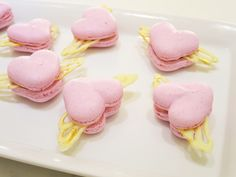 Cranberry macaron hearts with cranberry white chocolate filling and golden white chocolate wings. I've pictured flying macaron hearts in my mind for quite a while and am so glad I finally made these cuties! I left the ground almonds with some bigger bits on purpose and did not grind the almond-powdered sugar mixture this time, which made the shellsa bit more chewy and not as smooth as usual. The dried cranberries did not fully grind in blender and the filling stayed with chewy cranberry…
