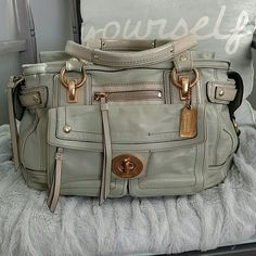 Authentic coach Hampton Lindsay Authentic rare leather mint coach bag. Bag has been HEAVILY used and is vintage. Gold hardware is scratched . comes with original coach hang tag. Missing one leather zipper pull seen in pic 2. Has 4 gold feet. Handles are discolored. Some piping on the bottom corner was coming out so it has been stitched up.  tons of compartments. Pic 3 has authenticity serial #. With all that being said, the bag has many flaws but a ton of life left, it may be cleanable. Ask…
