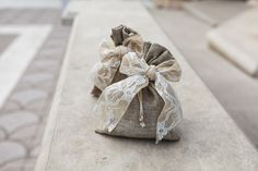 Romantic wedding favors with canvas bags and lace and burlap ribbon.