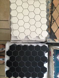 Interior floor treatment - black and white hex tiles.