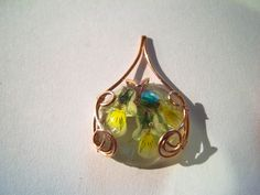 My firt resin cabochon, made with real pressed flowers.
