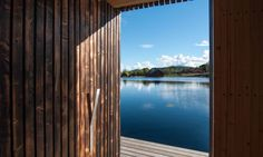 Small Architecture Workshop designed and built a floating sauna wrapped in blackened timber in Sweden.