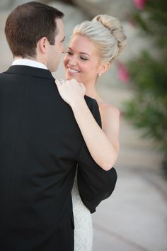 This bride started with her hair down and flowing -- then switched to this elegant bun for the reception. Love it! See more on Style Me Pretty: http://www.StyleMePretty.com/destination-weddings/2014/02/20/cabo-san-lucas-wedding/Amy Bennett Photography