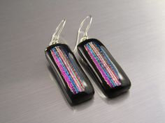Dichroic Fused Glass Earrings -  Stripes in Raspberry Pink and Blue on Black. $24.00, via Etsy.