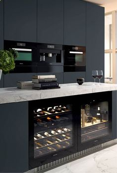 Wine Cooler - Miele Kitchen. I spy a decanter (which always comes in handy). Clean lines. Marble counter top. Built in wine cabinet. Lovely.