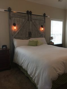 Custom made barn door headboard - queen with barn door track hardware and night lights