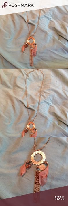 Adorable long gold necklace Has adorable gold circle and feathers!! Accepting reasonable offers Jewelry Necklaces