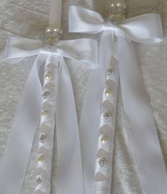 This elegant and traditional set of Greek Orthodox Wedding Candles are perfect for your Greek Orthodox Wedding Ceremony. Featuring white pearl beads and silver rhinestone accents on white 18 taper candles wrapped in white satin ribbon. Matching Stefanas and 32 alter candles are