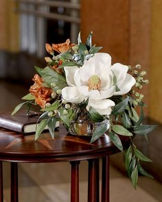 Southern Charm Silk Flower Arrangement, magnolia bloom, rust colored alstromeria, green garbanzo beans and smilax leaves. Beautiful fall decor or display all year! Silk Floral Arrangements, Artificial Flower Arrangements, Beautiful Flower Arrangements, Wedding Flower Arrangements, Floral Centerpieces, Table Centerpieces, Artificial Flowers, Beautiful Flowers, Wedding Flowers