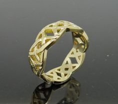 Gold Celtic Wedding Ring remodelled from existing Wedding and Eternity Rings, custom Designed and handmade by Peter Kumskov. Bespoke Jeweller Brisbane. 'My Own Jeweller Direct'. http://jewellerdirect.com.au/image/data/Gallery/Wedding%20Bands/Gold-Celtic-half-round-Wedding-Band-remodelled-web-1.jpg