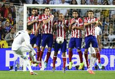 Raúl García Escudero, (second player from the right) soccer player of Atletico Madrid, was wearing Nike Magista Obra during the Champions League Final game played in Lisbon against Real Madrid.