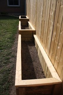 raised vegetable garden against fence? Exactly what I want. Now to convince hubby...or a son in law!!