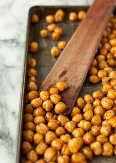 How To Make Crispy Roasted Chickpeas in the Oven | Those cans of chickpeas sitting in your cupboard have been hiding an amazing secret. Roasted in the oven, chickpeas transform into a crispy, salty, savory snack. So tiny. So easy to eat by the handful.
