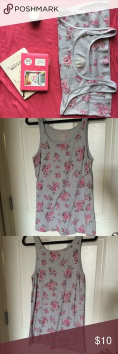 Long and lean floral tank Light indigo ribbed long and lean tank with floral pattern. Great for layering. Only worn once. 94% cotton, 6% spandex. Mossimo lists as size 2 but in plus range that's 2X. Probably more appropriate for 1X. Mossimo Supply Co Tops Tank Tops