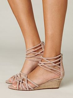 Blush colored go with everything wedge sandals.I love the feminine detail at the ankle.