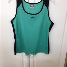 Nike sleeveless green and black tank Nike green and black sleeveless tank. Size M. Excellent condition Nike Tops Tank Tops