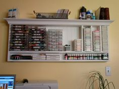 I want this scrapbooking room!  Nice organization and they built everything!