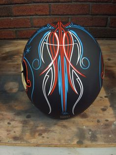 Pinstriping is appliying a thin line of paint to a surface to enhance the curves and provide a visual artwork. Here is how to pinstripe a motorcycle helmet. Black Motorcycle Helmet, Custom Motorcycle Helmets, Custom Helmets, Women Motorcycle, Scrambler Motorcycle, Rat Rods, Pinstripe Art, Pinstriping Designs, Helmet Paint