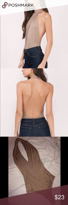 Tobi Bodysuit // New to wear A wrap halter bodysuit featuring a wrap front and halter neckline. Will look super cute paired with high waisted shorts or skirt. **This item has not been worn out yet and still holds the brand's tags. Tobi Tops Blouses