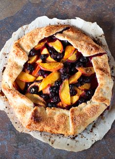 Packed with fresh peaches and blueberries, this Peach and Blueberry Galette is the ultimate summer dessert. Summer Desserts, Just Desserts, Delicious Desserts, Yummy Food, Tart Recipes, Dessert Recipes, Cooking Recipes, Yummy Recipes, Crostata Recipe