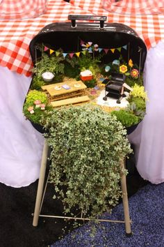 Upcycle your barbecue with this idea to make a pretty fairy garden.