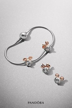 Play with the classic two-tone silhouettes and sparkling pieces from our new Disney PANDORA ESSENCE COLLECTION. Strike a pose with Mickey Mouse or channel Minnie Mouse's signature style with feminine heart and bow details, all crafted with high-quality materials.