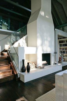 White stucco over river rocks in the downstairs living room and have built in stucco seating on both sides